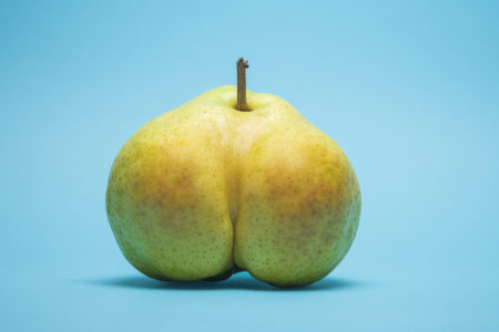Suggestively shaped cross section of a pear over blue background